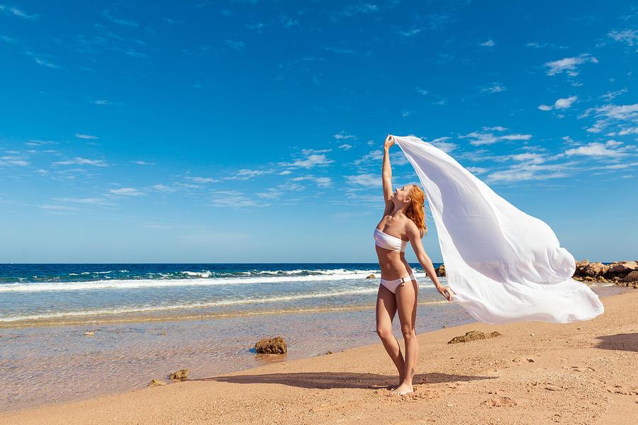 Carefree Girl On The Beach Photograph