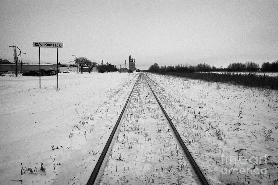 Station Photograph - Cn Canadian National Railway Tracks And Grain Silos Kamsack Saskatchewan Canada by Joe Fox