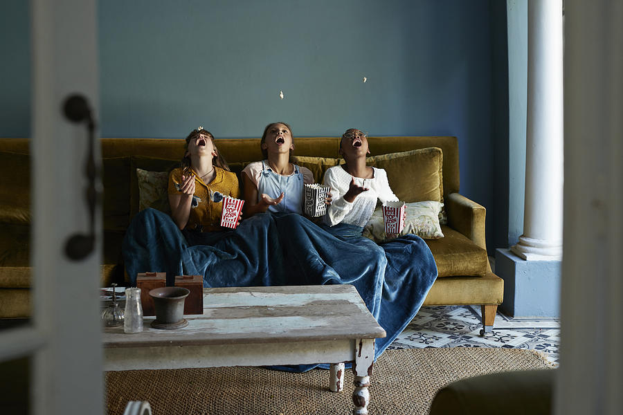 3 Friends Catching Popcorn With The Mouth Photograph by Klaus Vedfelt