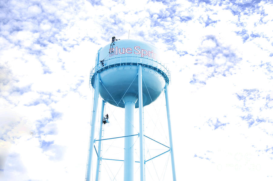 Image result for men on water tower