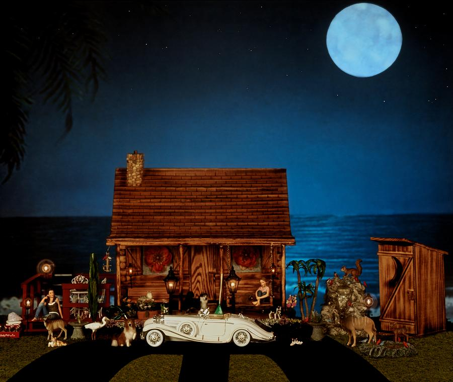 Log Cabin Photograph - Miniature Log Cabin Scene With The Classic 1936 Mercedes Benz Special Roadster In Color by Leslie Crotty