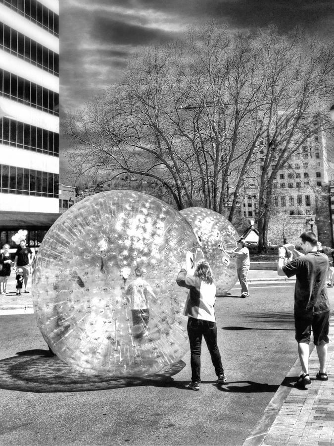 Kids In Balls At Festival Photograph - Pack Sq.  by Mark Block