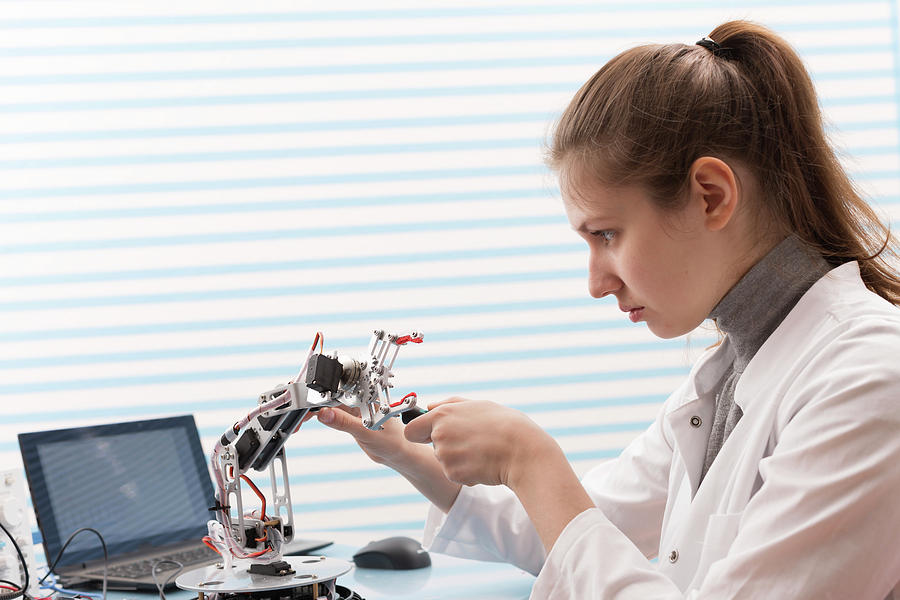 Female Photograph - Technician Soldering Wires In Lab by Wladimir Bulgar/science Photo Library