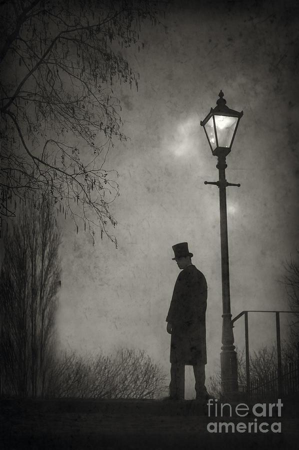 Victorian Man Standing Next To An Illuminated Gas Lamp ...