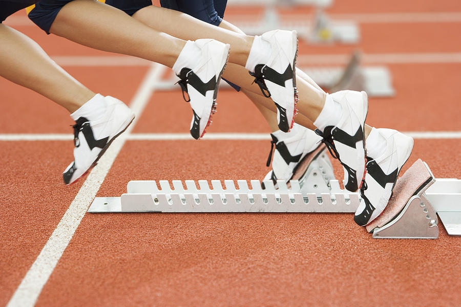 Starting Blocks Photograph - Athlete Leaving The Blocks by Gustoimages/science Photo Library