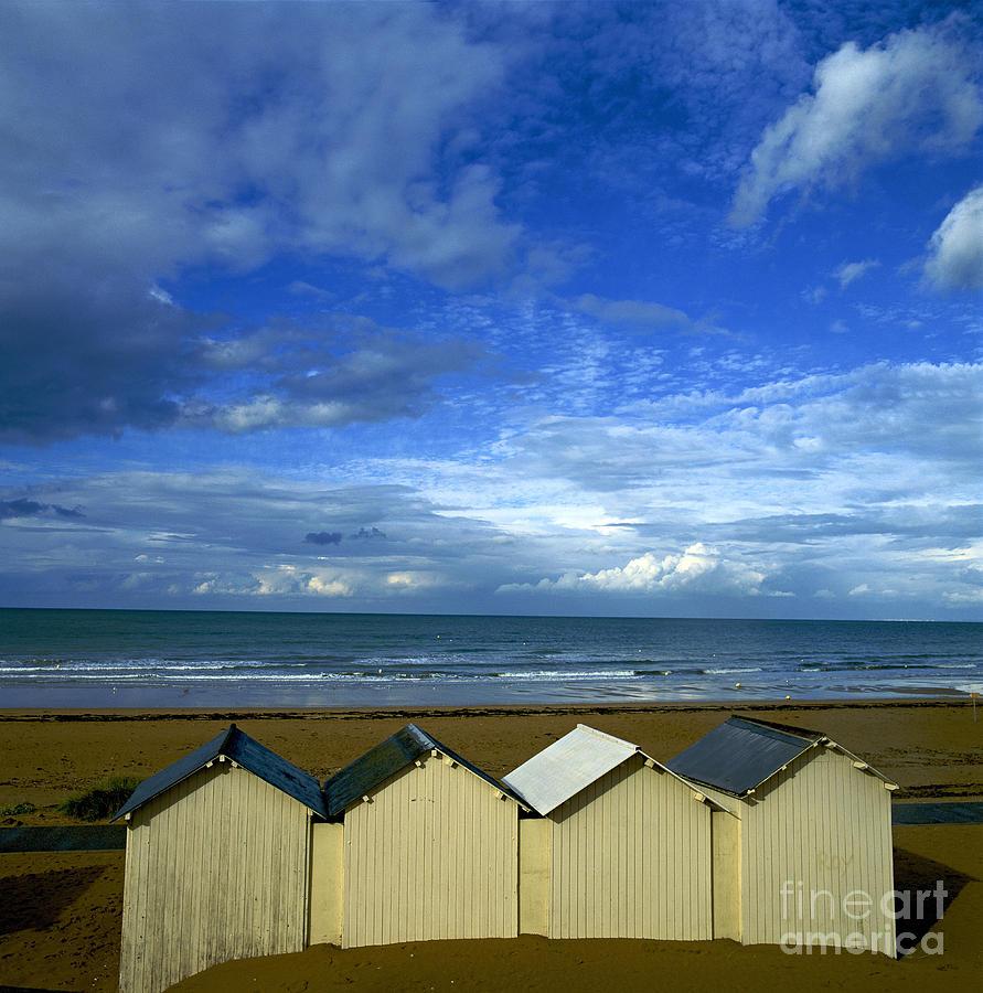 Beach Huts Under A Stormy Sky In Normandy. France. Europe Photograph by Bernard Jaubert