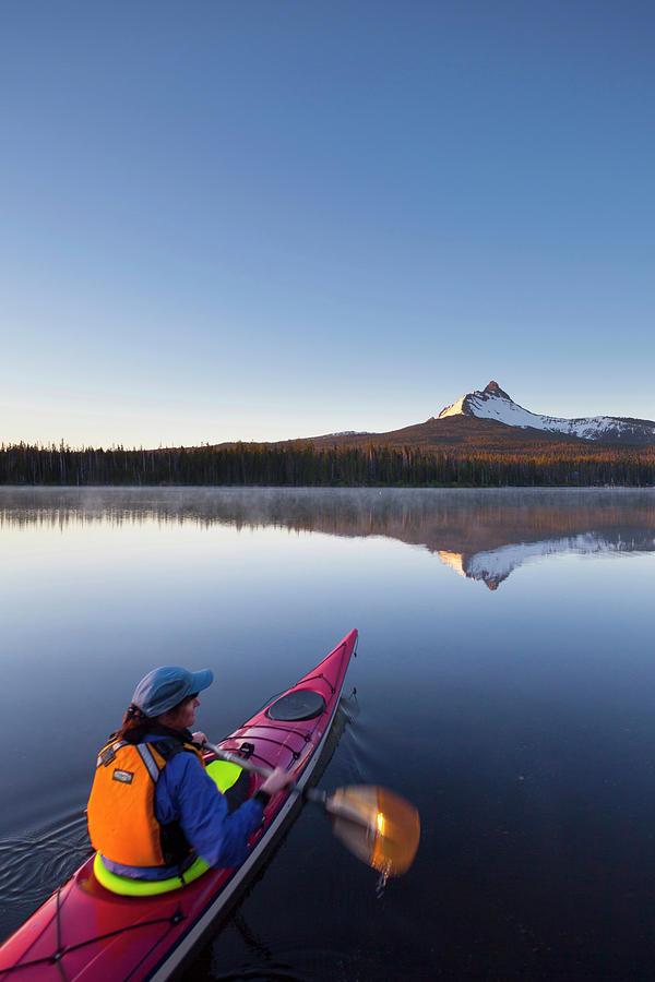 Adventure Photograph - Usa, Oregon A Woman In A Sea Kayak by Gary Luhm