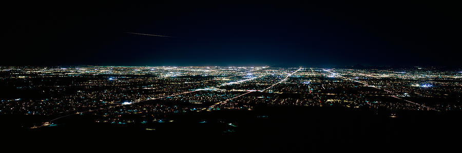 Color Image Photograph - Aerial View Of A City Lit Up At Night by Panoramic Images