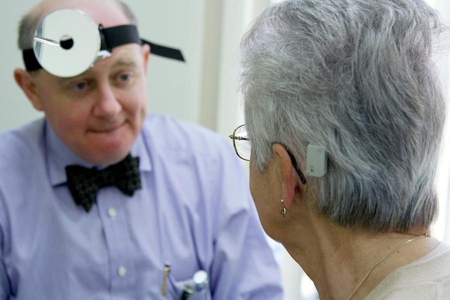 Baha Photograph - Baha Hearing System Check-up by Life In View/science Photo Library