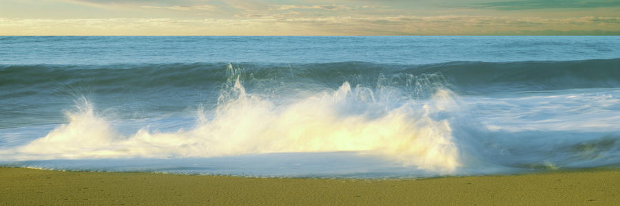 Horizontal Photograph - Waves Breaking On The Beach, Playa La by Panoramic Images