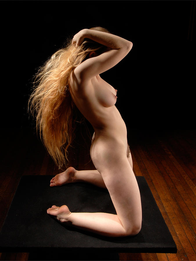 Nude Woman Kneeling On Floor Stock Photo