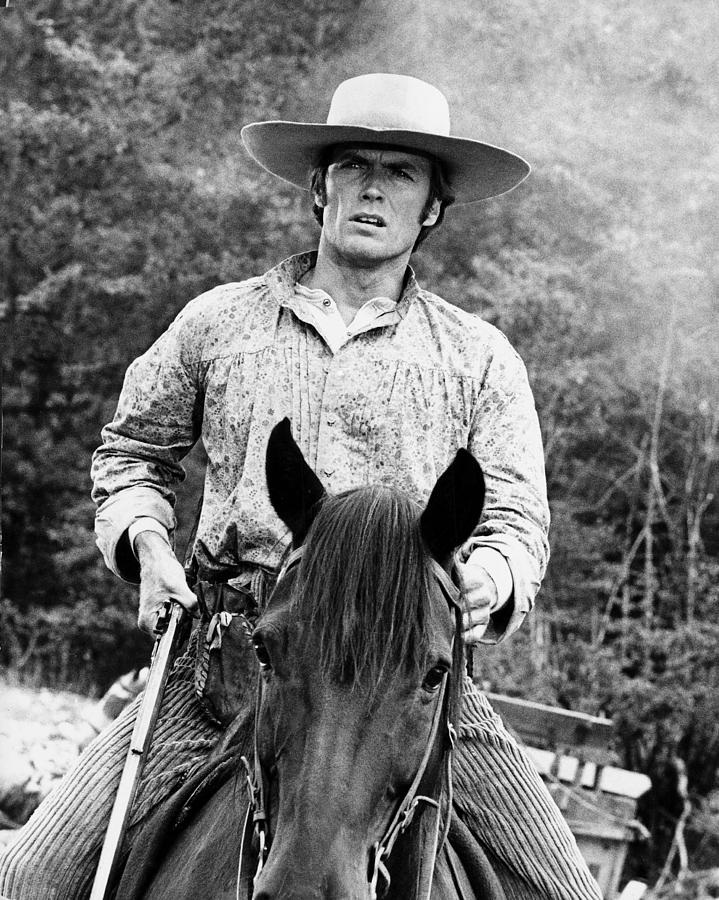 Image result for  clint eastwood riding a horse