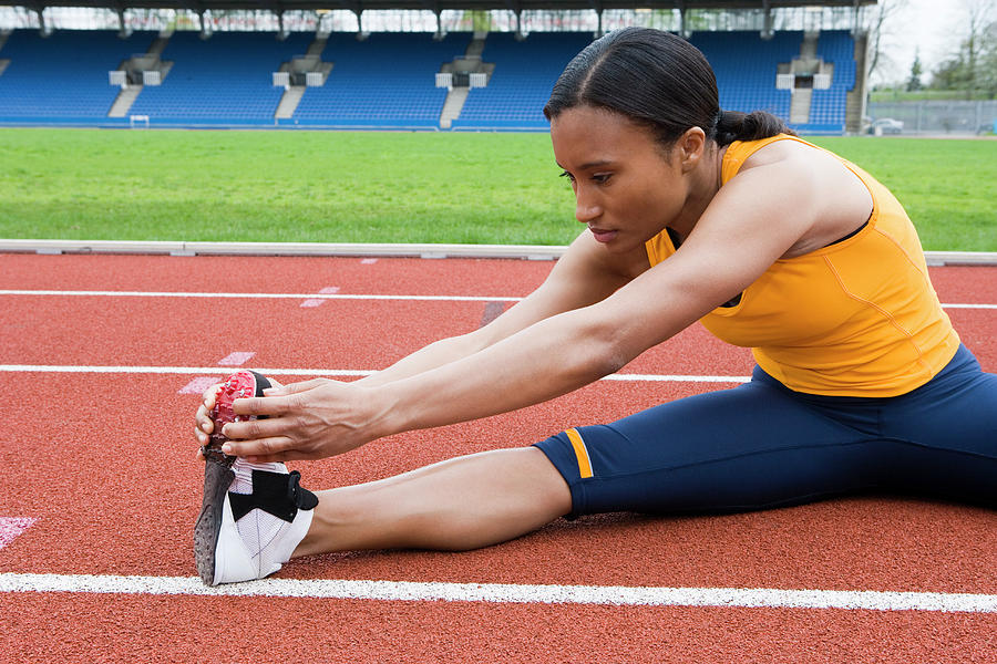 Human Photograph - Athlete Stretching by Gustoimages/science Photo Library
