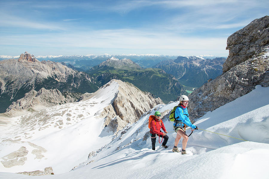 Snow Photograph - Climbing At Via Ferrata Ivano Dibona by Marcos Ferro