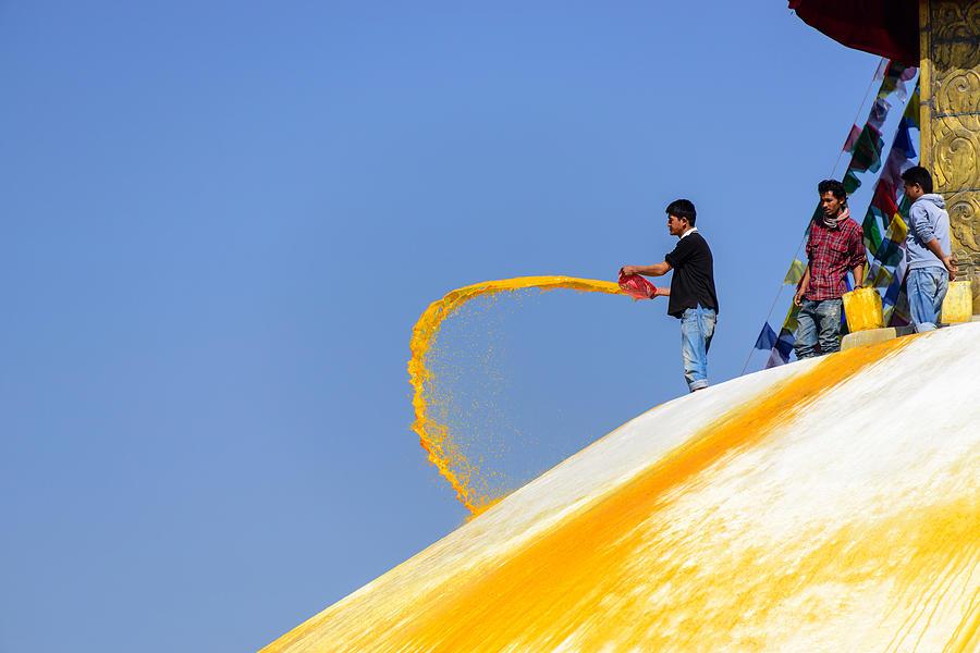 Bodnath Photograph - Man Throwing Orange Paint On Boudhanath Stupa by Dutourdumonde Photography