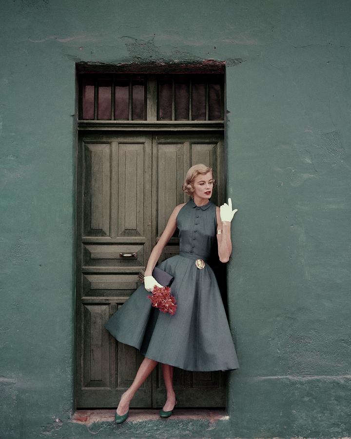 A 1950s Model Standing In A Doorway Photograph by Leombruno-Bodi