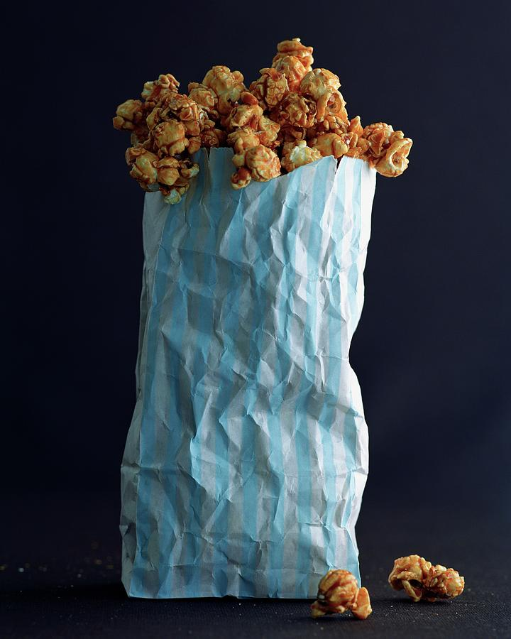 A Bag Of Popcorn Photograph by Romulo Yanes