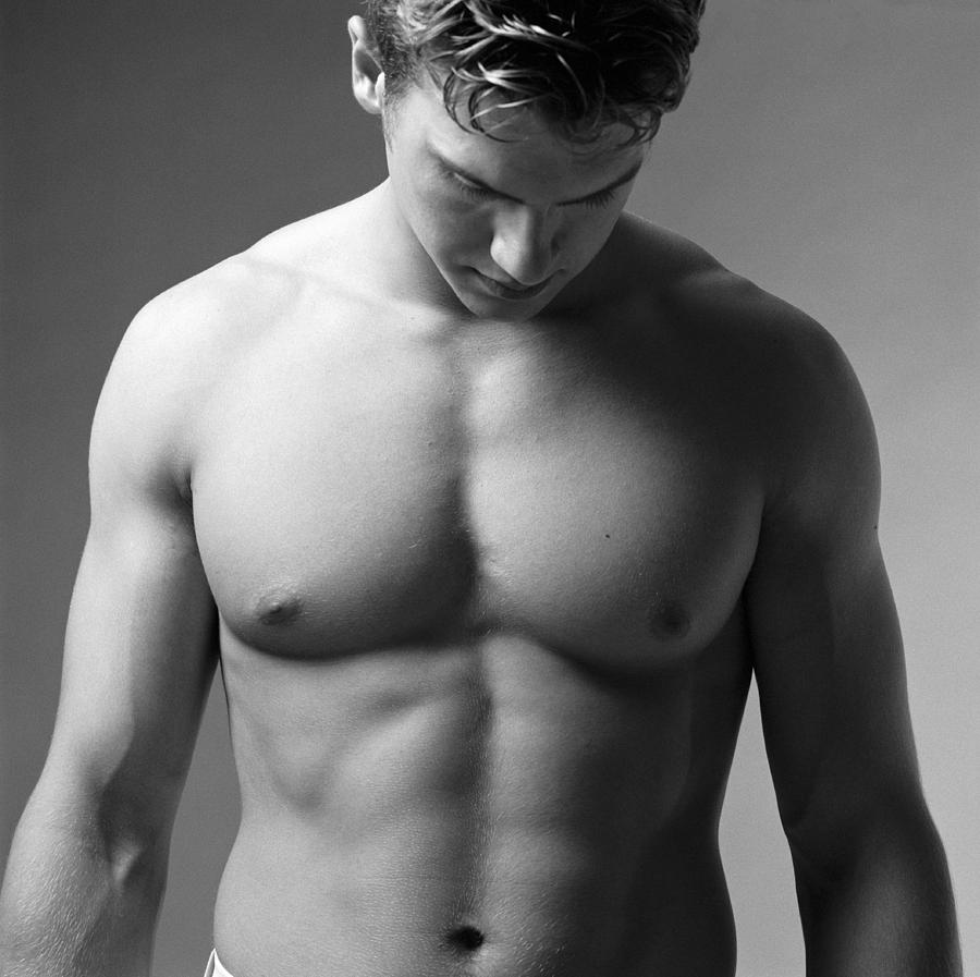 A Bare Torso Of A Muscular Caucasian Male Photograph by Photodisc
