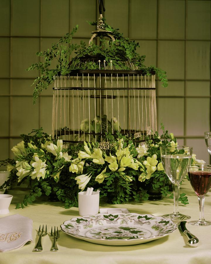 A Birdcage In The Middle Of A Table Photograph by Wiliam Grigsby