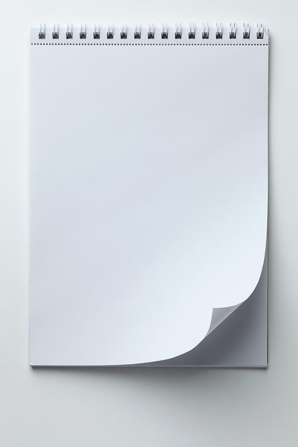 A Blank Sketch Pad With Curled Up Page Photograph by Caspar Benson
