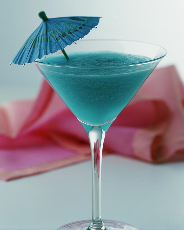 A Blue Hawaiian Cocktail Photograph by Romulo Yanes