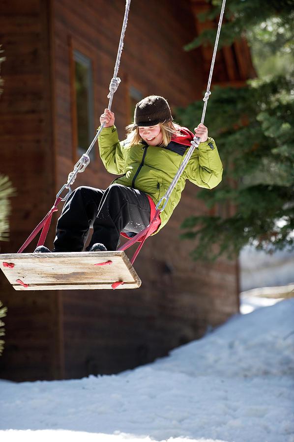 Boys Photograph - A Boy Plays Outside In Lake Tahoe by Corey Rich