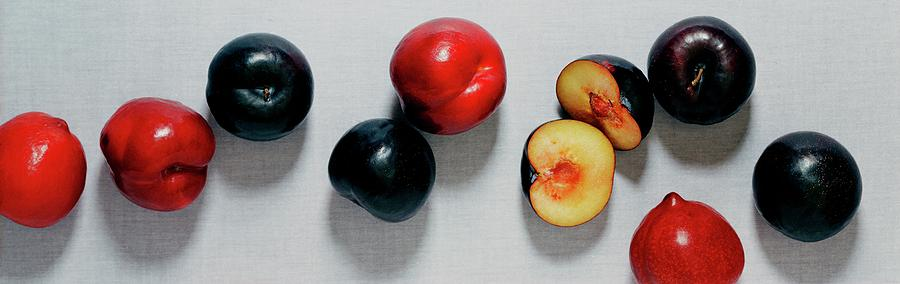 A Bunch Of Plums Photograph by Romulo Yanes