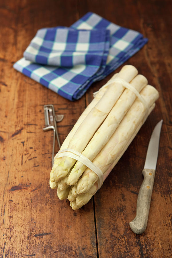 A Bunch Of White Asparagus On A Wooden Photograph by Ursula Alter