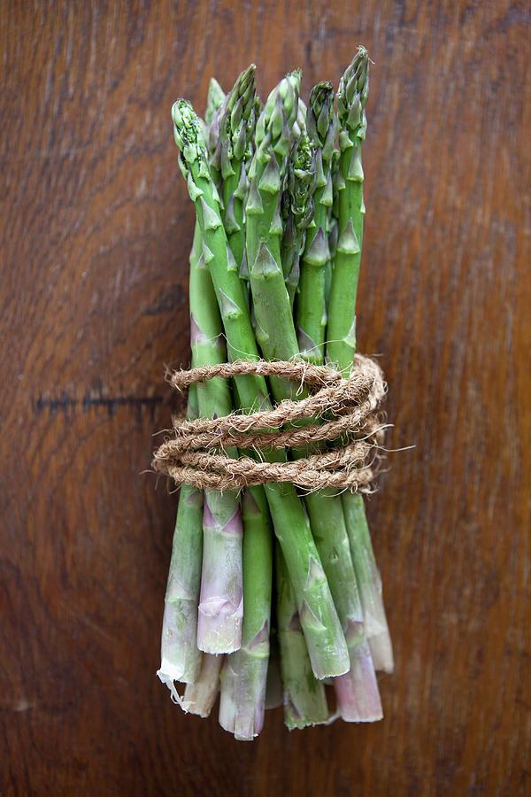 A Bundle Of Asparagus Photograph by Halfdark