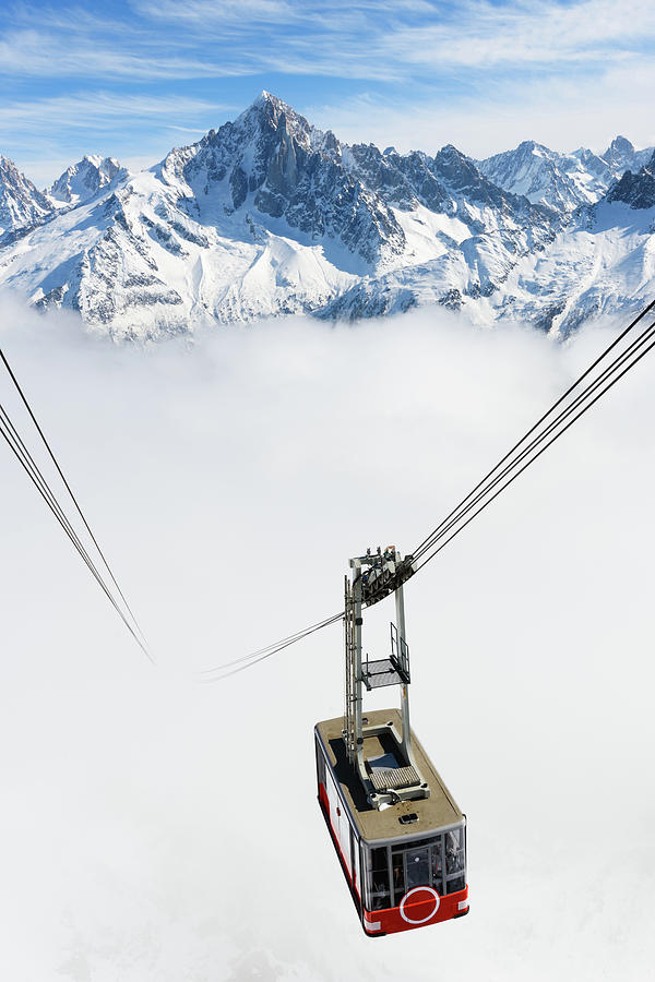A Cable Car Traveling Up A Snowy Photograph by Alexsava