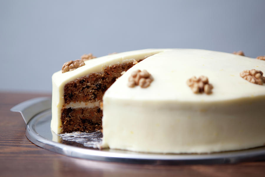 A Carrot Cake With A Slice Missing For Photograph by Halfdark
