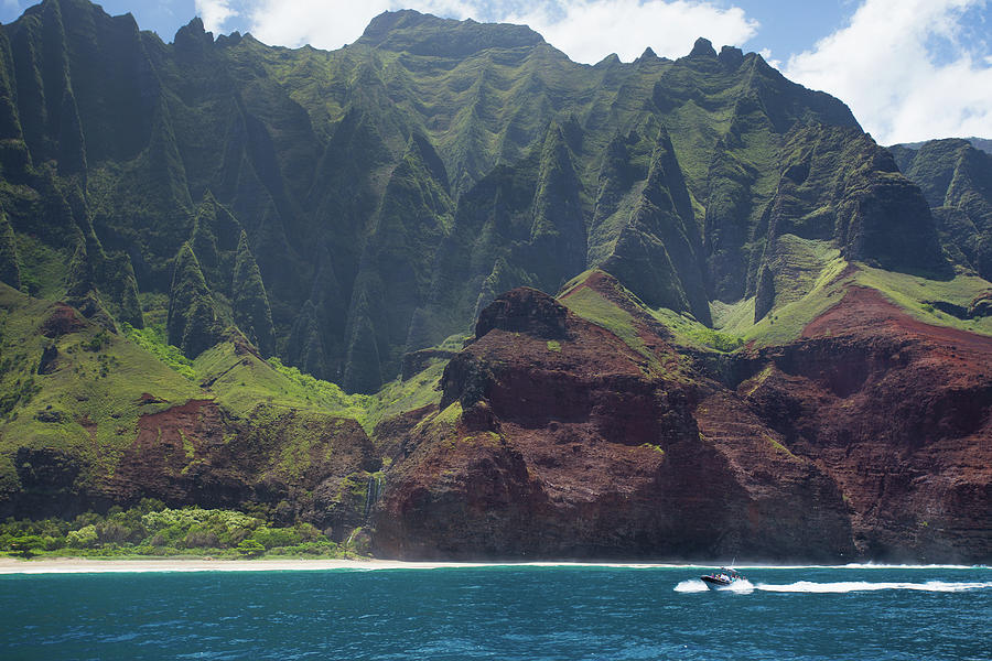 A Catamaran Cruises Along The Napali Photograph by Matthew Micah Wright