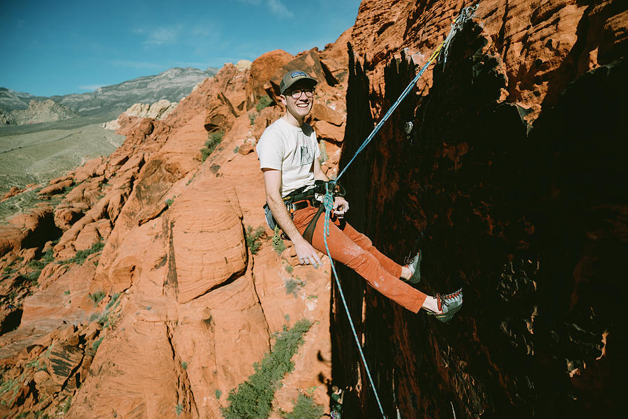 Day Photograph - A Climber On Panty Wall In Red Rock by Ryan Tuttle