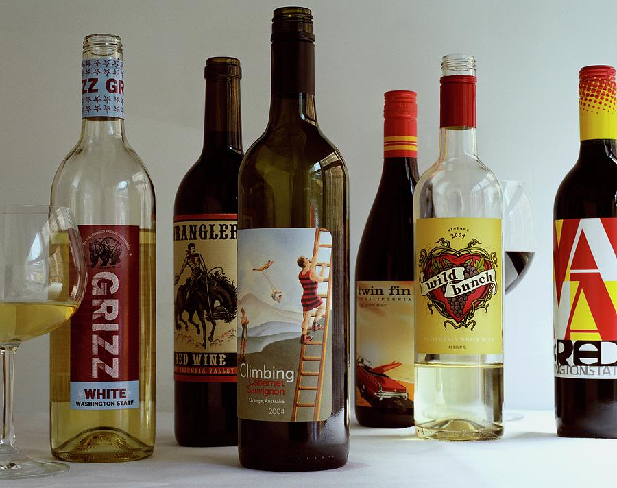 A Collection Of Wine Bottles Photograph by Romulo Yanes