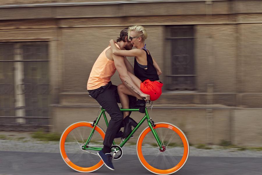 A Couple Biking Through The City Photograph by Justin Case