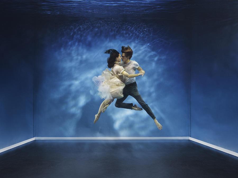 A couple dancing under water Photograph by Henrik Sorensen