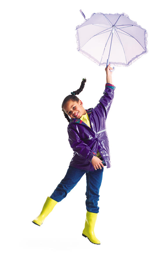 A Cute Little African American Girl In A Rain Jacket Jumps Into The Air With Her Umbrella Photograph by Photodisc