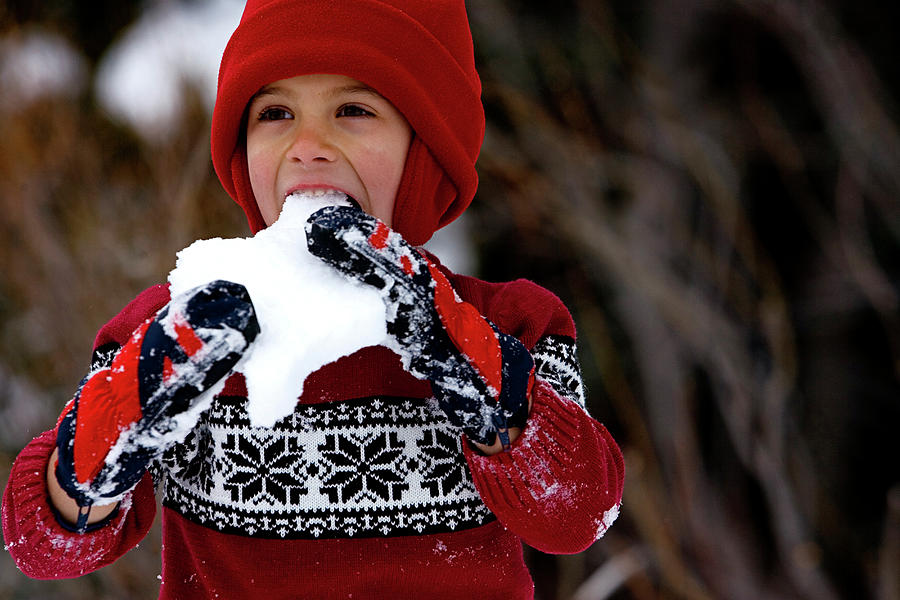 Beanie Photograph - A Cute Young Boy Eating Snow by Corey Rich