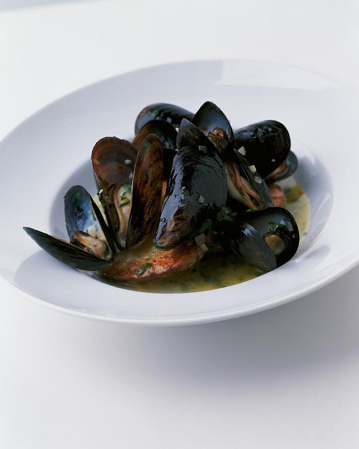 A Dish Of Mussels Photograph by Romulo Yanes