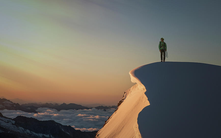 A Female Climber On A Snowy Mountaintop Photograph by Buena Vista Images