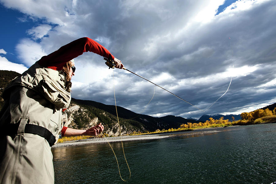 Autumn Photograph - A Fly Fisher Casting His Line by Patrick Orton