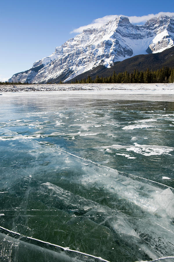 A Frozen Mountain Lake Snow Free With Photograph by Michael Interisano / Design Pics