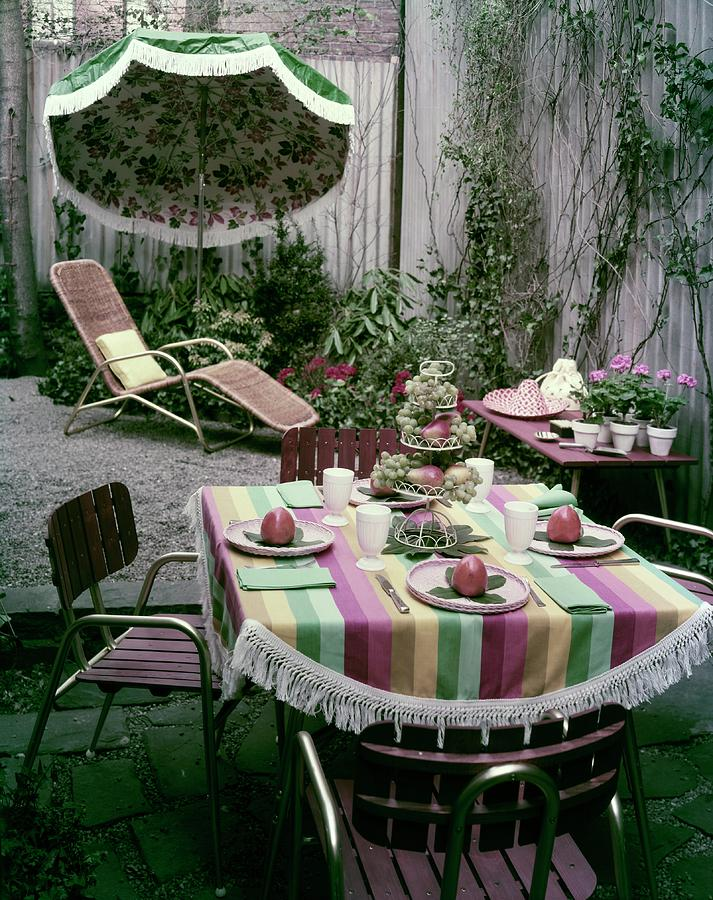 A Garden Set Up For Lunch Photograph by Tom Leonard
