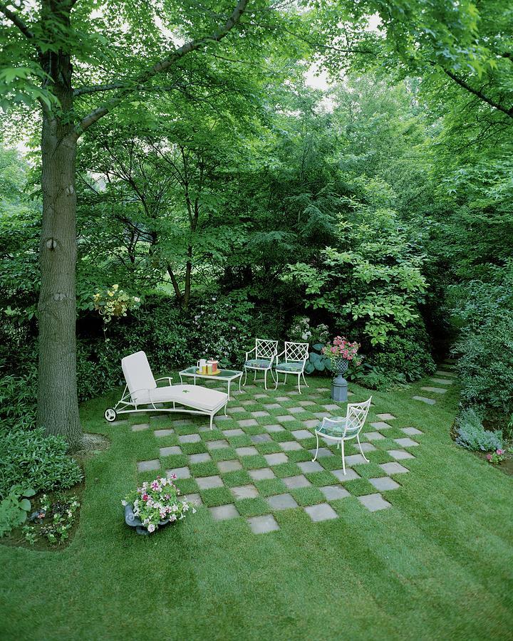 A Garden With Checkered Pavement Photograph by Pedro E. Guerrero