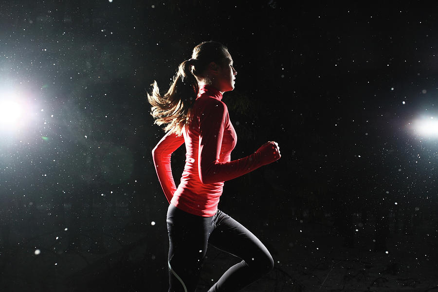 A Girl Running At Night Surrounded By Photograph by Stanislaw Pytel