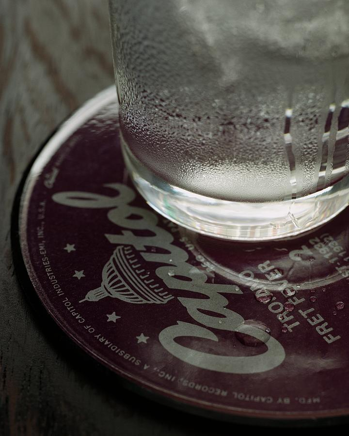 A Glass On A Coaster Photograph by Romulo Yanes