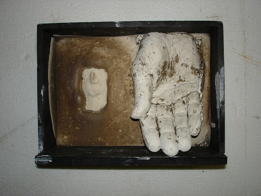 A God In Hand Relief by Marc David Leviton