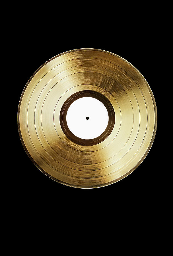 A Gold Record On A Black Background Photograph by Larry Washburn