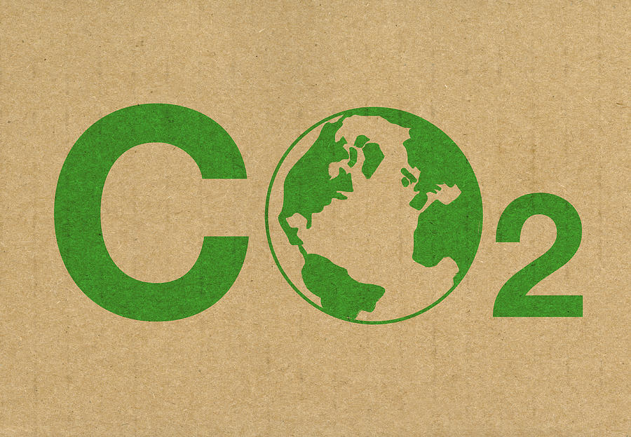 A Green Co2 Logo On A Brown Cardboard Background Photograph by ChrisSteer