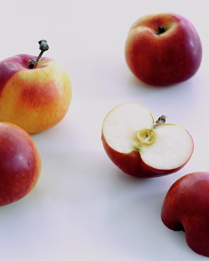 A Group Of Apples Photograph by Romulo Yanes